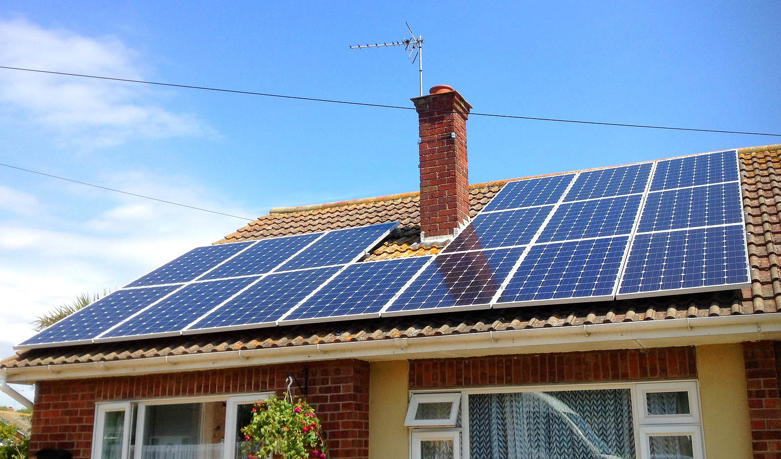 Large set of solar panels installed by Green Solar World over a detached house near Cambridge