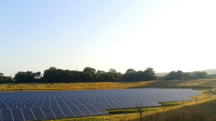 Large solar panel farm near Cambridge cleaned by Green Solar World