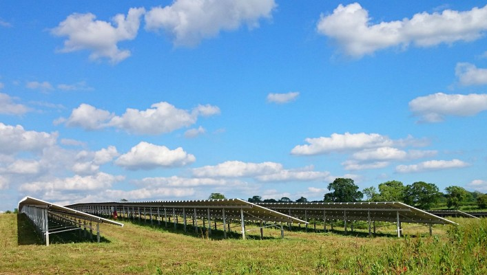 Summer day solar farm near Cambridge after cleaning working at full capacity