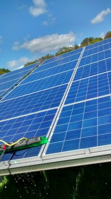 Solar panels near Cambridge cleaning in progress
