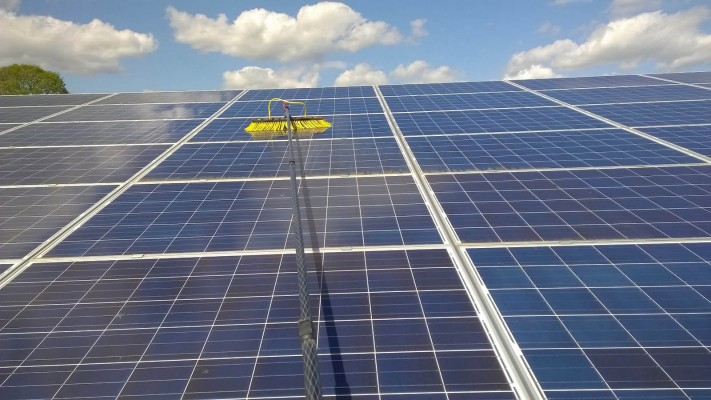 Solar panel farm near Cambridge cleaning in progress