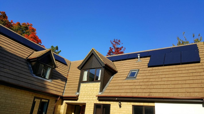 Multiple solar panel installations over a housing estate in Cambridge