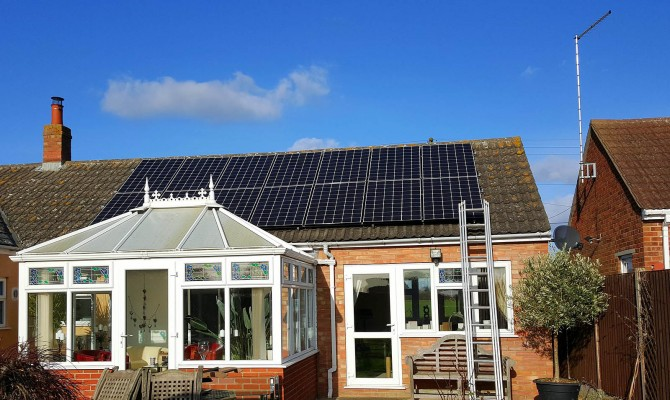 Fourteen solar panels on a medium bungalow house near Cambridge