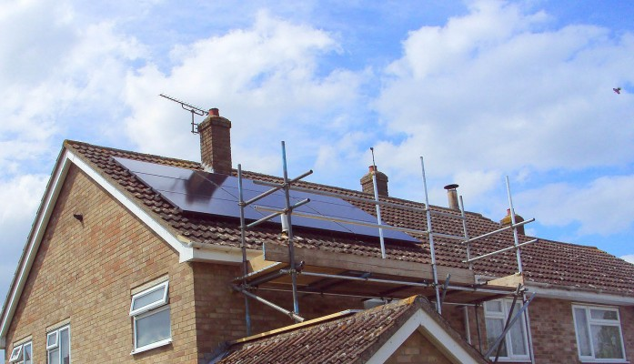 Nine large solar panels producing electricity for a family from Cambridge