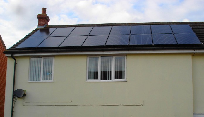Sixteen solar panels generating large amount of energy for a family living in a semi-detached house in Cambridge