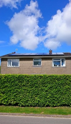 Beautiful summer day and solar panels generating electricity for a family living in a detached house in Cambridgeshire
