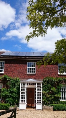 Large detached house in Cambridge outskirts with massive solar panels producing electricity