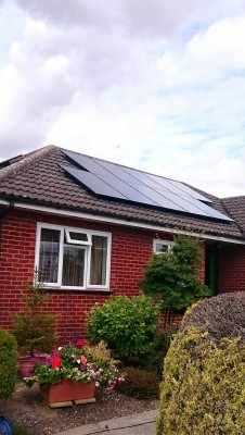 Bungalow house near Cambridge with a set of ten solar panels generating electricity