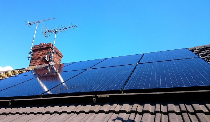 Eight solar panels generating enough electricity for a small family living in a bungalow near Cambridge