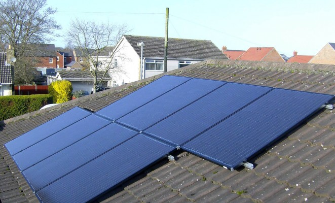 Cambridge neighbourhood and eight solar panels producing electricity