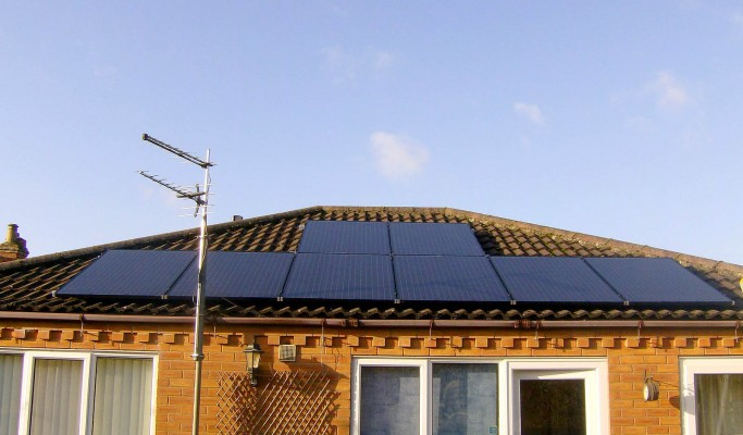 Eight solar panels over a bungalow house near Cambridge producing energy
