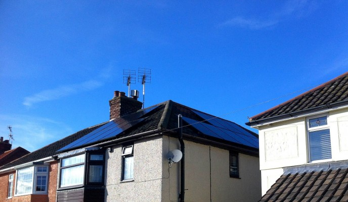 Cambridge village house with two sets of solar panels producing green energy