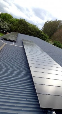 Solar panels on a roof of a farm warehouse in Cambridgeshire