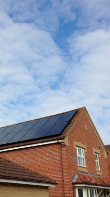 Large detached house with large number of solar panels near Cambridge